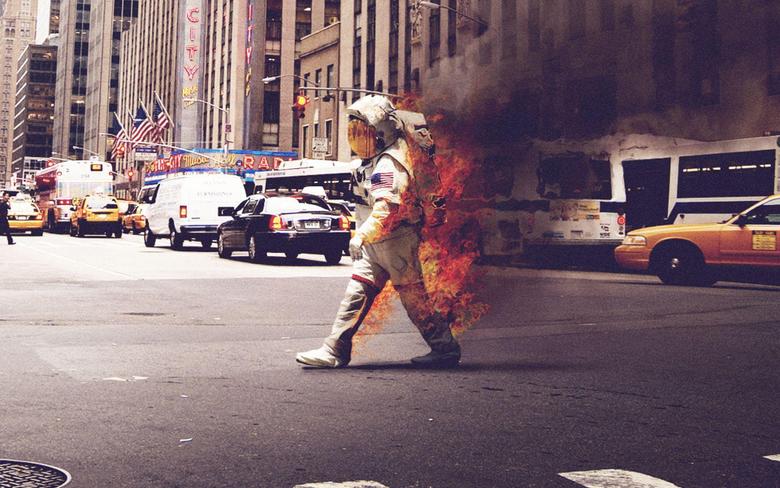 Astronaut on Fire walking down a street wallpapers