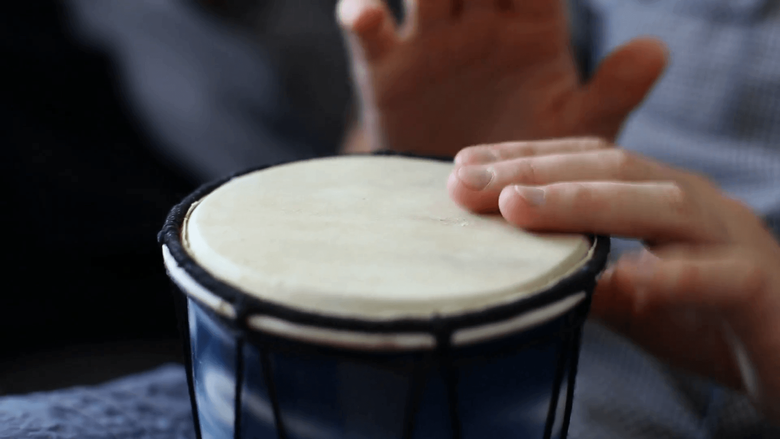 Playing Bongo drum close up HD stock footage Hand tapping a Bongo