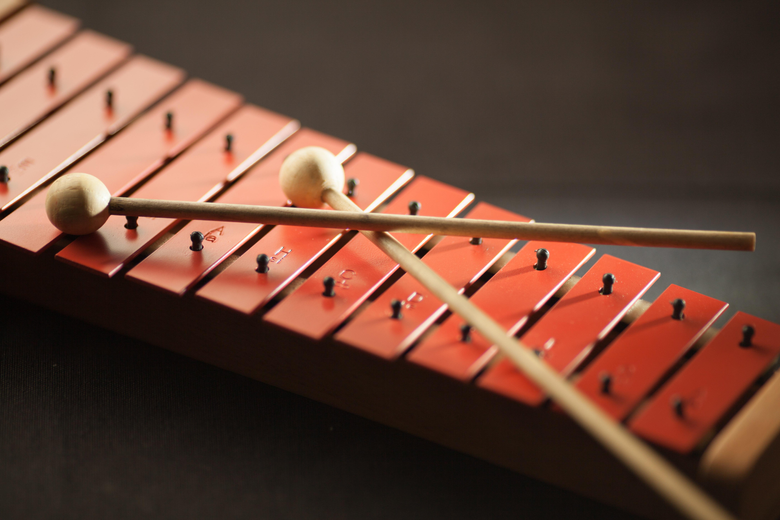 Shallow Focus Photography of Red Xylophone Stock Photo