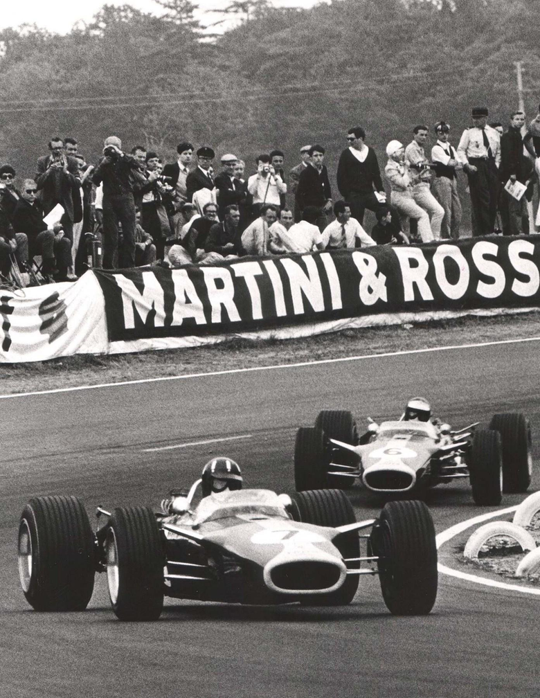 Jim Clark and Graham Hill dueling in their Lotus 49s during the 1967
