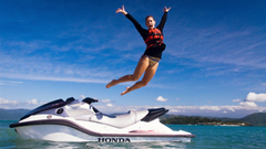 High Definition Wallpapers Of A Woman Jumping Out Of A Jetski