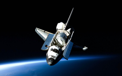 Space Shuttle Discovery posing for a great wallpaper space