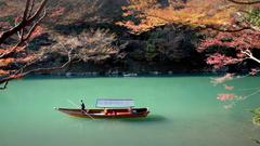 Rowing boat on Katsura river Arashiyama Japan