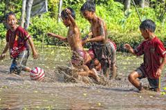 Jogjakarta Ball Child Mud Yogyakarta boys childhood image
