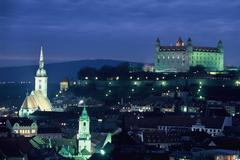 cityscapes night lights hills buildings Slovakia capital