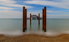 Brown wooden pillar on body of water brighton HD wallpapers