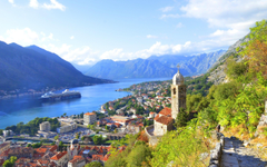 Kotor Bay Montenegro river mountains city houses clouds