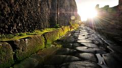 Ruins Italy moss antique cobblestones Italia Pompei street sun flare