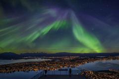 Tromsø winter city directly beneath the Northern Lights
