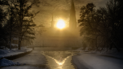 BOTPOST ITAP of the sun rising behind Uppsala Cathedral in winter