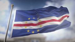 Cape Verde Flag Waving Slow Motion 3D Rendering Blue Sky Backgrounds