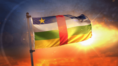 Central African Republic Flag Backlit At Beautiful Sunrise Loop Slow