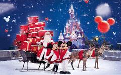 Santa Claus bringing gifts in a Disneyland park wallpapers