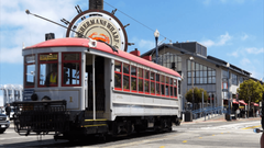 a cable car travels past the famous fisherman s wharf district of