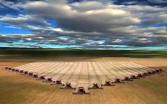 Combines harvesting wheat in I believe North Dakota