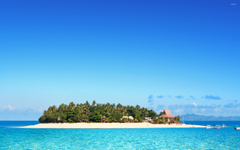 Clear sky over a resort on a Fiji island wallpapers