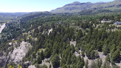 Aerial drone scene of houses in the woods in mountain in south