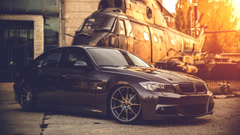 Black BMW E90 With A Helicopter Wallpapers