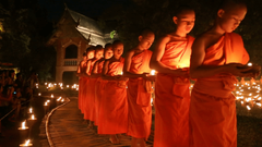 Magha puja day Monks light the candle for buddha Chiangmai
