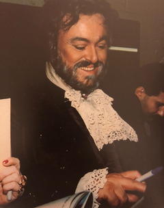 Luciano Pavarotti signs autographs backstage after a performance of