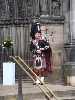 men s scotland traditional dress and bag pipe image
