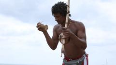 Brazilian playing Berimbau Instrument in Salvador Bahia Brazil