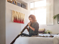 Alternative Unusual Musical Instrument Didgeridoo Player At Home
