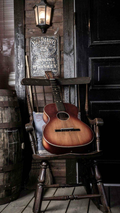 Old Guitar On Chair
