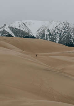 HD Wallpaper The silhouette of a lone hiker among sand dunes with