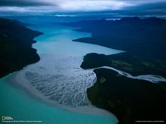 The Tlikakila River flows into Alaska s Lake Clark carrying ash