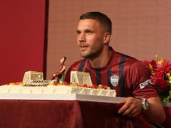 J1 League News Breitbart apologises to Podolski for picture blunder