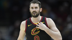 Kevin Love leaves after taking elbow to the face