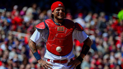 catcher Yadier Molina can t find the ball because it s stuck to