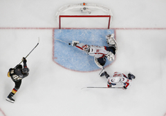 An NHL photographer captured an incredible image of Holtby s save