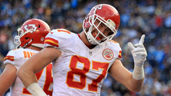 Chiefs Travis Kelce arrives for playoff game using shoe as phone
