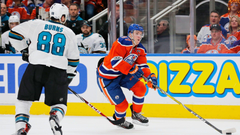 Brent Burns Connor McDavid getting held in check
