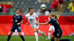 Lucy Bronze of England is challanged by Amandine Henry of France