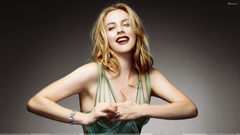 Alicia Silverstone Laughing In Green Top Pose Wallpapers