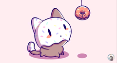 Cute cat playing with donut toy