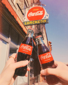 coke shop and two bottles